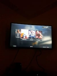 black flat screen TV with remote Edmonton, T5H 2T5