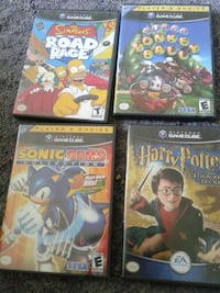 four assorted Nintendo game cube cases