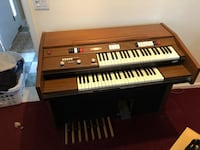 brown and white upright piano Great River, 11739