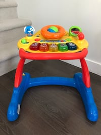 Vtech sit to stand walker  Coquitlam, V3J 0E3