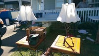 Two wrought iron lamps Surrey
