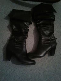 pair of black leather heeled thigh high boots Prince Albert