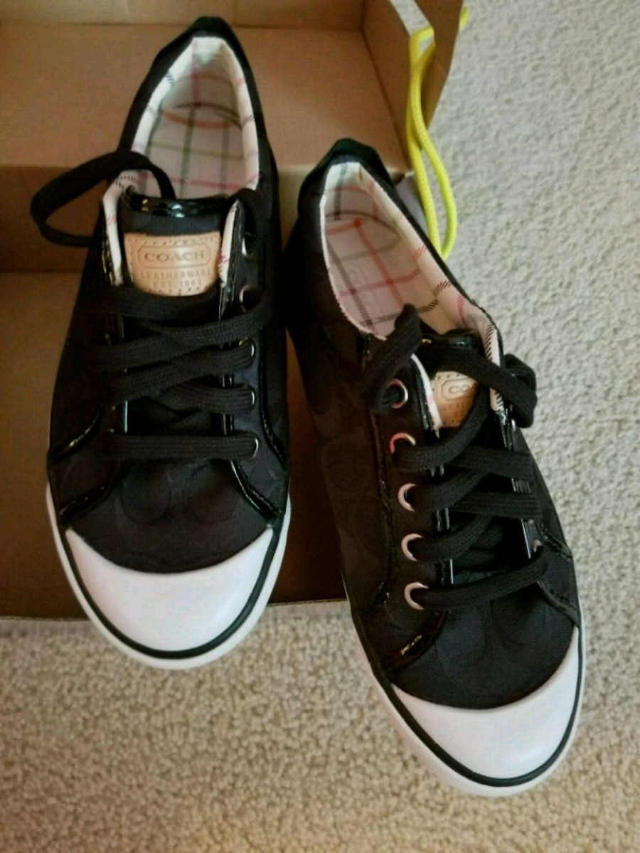 Photo Pair of black-and-white COACH sneakers