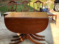 brown wooden table with 4 chairs and three leaves Clinton, 20735