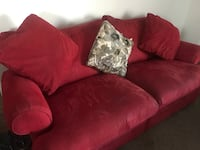 red fabric sofa with throw pillows