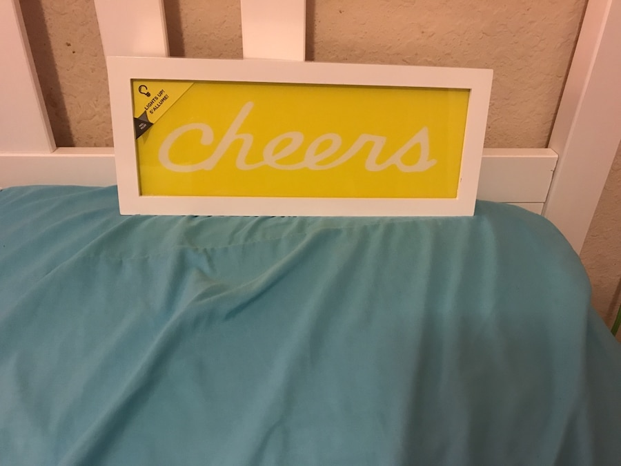Used yellow and white wooden wall decor in Orlando - letgo