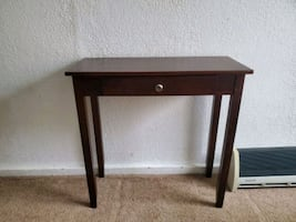 Brown wooden single drawer table