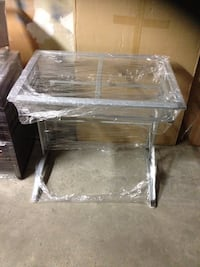 rectangular clear glass top table with black wooden base Brampton, L6V 3W7