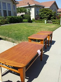 rectangular brown wooden coffee table and two square brown wooden end tables Las Vegas, 89166