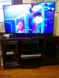 television stand with glass doors for storage  417 mi