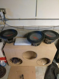 three black and gray coaxial speakers ; brown wooden enclosure speaker