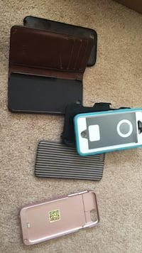 Portable charger case, otter box case, fossil wallet case and two others  Ridgecrest, 93555