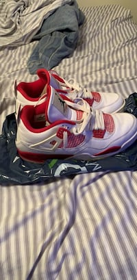 Pair of white-and-red nike basketball shoes Tallahassee, 32304