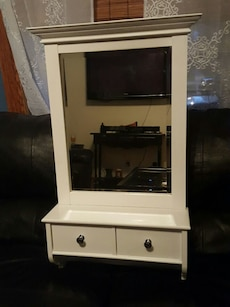 white wooden hall tree bench with mirror