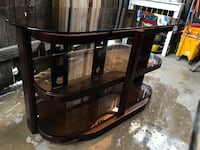 Brown wooden framed glass top tv stand Bakersfield, 93309