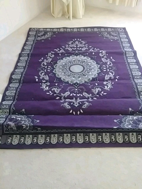 purple and white floral area rug