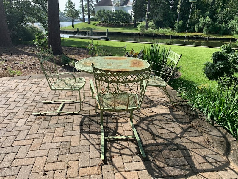 Vintage wrought iron patio outdoor table n 4 chairs 50+ yrs old. 4101a7c3-1349-4065-8acc-dd8b8e00bcc7