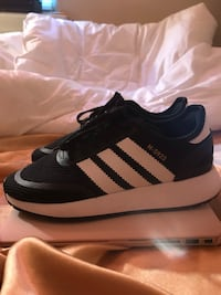 Black-and-white adidas low-top shoes 54 km