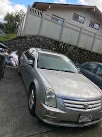Silver-colored Cadillac STS