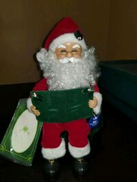 Santa Claus holding red ceramic figurine Woodbridge, 22192
