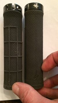 1 pair of black Specialized Mtn bike grips.