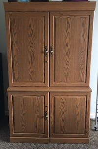 Brown wooden 2-door computer cabinet. Must go ASAP. Cash and pick up only  Frederick, 21703
