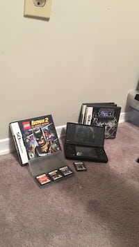 black Nintendo DS with games cartridges Richmond Hill, L4C 9Y9