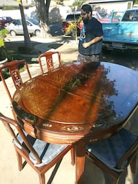 round brown wooden table with four chairs dining set Oxnard, 93033
