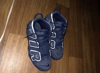 pair of black Nike Air Foamposite Pro shoes null