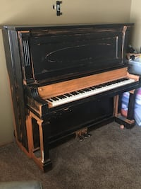 Black and brown upright piano