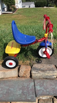 Toddler's red and blue Radio Flyer trike