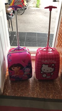 two pink and purple Hello Kitty luggage bags Montréal, H1H 3M7