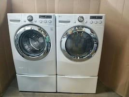 two grey front load washing machine