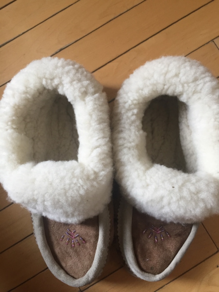 Pair of brown and white fur moccasins - Calgary