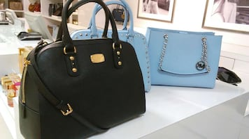 Black leather two way handbag and teal leather michael kors tote bags