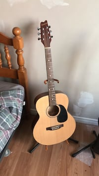 brown and black acoustic guitar Calgary, T2C 0V4