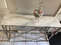 New console table with metal and real marble top see pictures size LxWxH 45.5x15x31 asking $260 contact Richard  [TL_HIDDEN]  Toronto, M9V 4T4