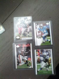 four american football trading cards
