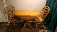 round brown wooden table with four chairs dining s Hamilton, L8G 4G8