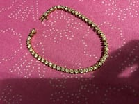 two gold-colored necklaces 546 km