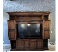 Flat screen television with brown wooden tv hutch Leesburg, 20176