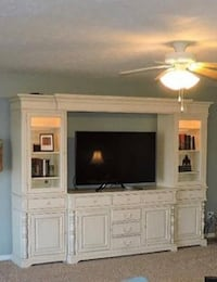 Paula Deen white 4 piece TV console. Comes with lights in side cabinets, additional glass/screen door cabinet fronts. Like brand new! Asking price or better offer Germantown, 45327