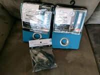 two teal Mainstays shower panel packs