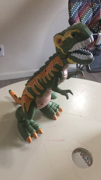 green and orange dinosaur with sharp teeth toy Lincoln City, 97367