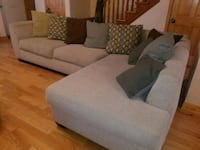 White -grey sectional fabric sofa with lots of pil Queens, 11375
