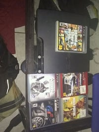 black Sony PS3 slim console with controller and ga Columbia, 29210