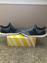 pair of black-and-white adidas running shoes Algonquin, 60156