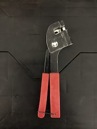 black and red handled knife 2210 mi