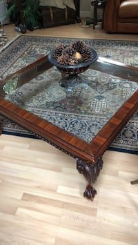 Brown wooden framed glass top coffee table Westborough, 01581
