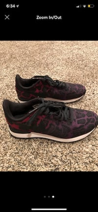 pair of black-and-pink Nike running shoes